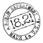 18.21 Man Made logotyp w stylu pieczatki z mozno wyeksponowanymi cyframi 18.21 ma kształt koła i jest czarne